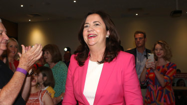 Queensland Premier Annastacia Palaszczuk is applauded by her father, Labor stalwart Henry, as she wins a third term in office.