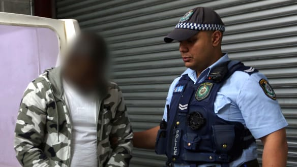 Husband and wife charged over alleged $3m detention centre love scam