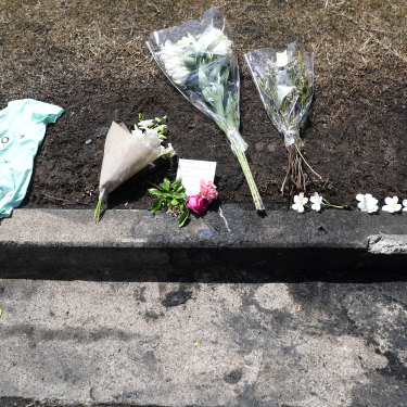 Flowers are left at the scene of a car fire which claimed the lives of a mother and her three young children.