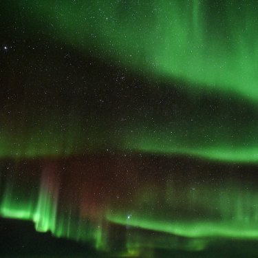 The breathtaking Aurora Australis view from onboard the flight.