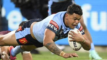 Latrell Mitchell crosses in NSW's big win.