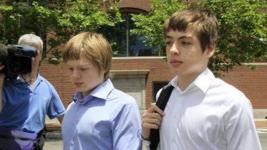Alexander Vavilov, right, and his older brother brother Tim leave a federal court after a bail hearing for their parents Donald Heathfield and Tracey Ann Foley, in Boston, Massachusetts, in 2010.