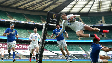 Jonny May of England dives over Luca Sperandio of Italy to score their side's third try during the Guinness Six Nations match between England and Italy.