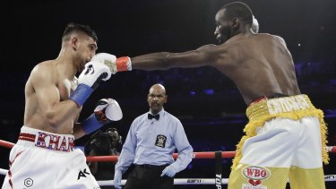 Landing a blow: Terence Crawford, right, connects to the head of England's Amir Khan during the second round of their WBO world champioship bout.