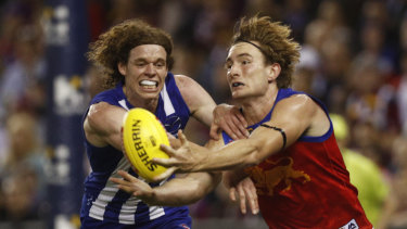 Harris Andrews of the Brisbane Lions competing with North's  Ben Brown.
