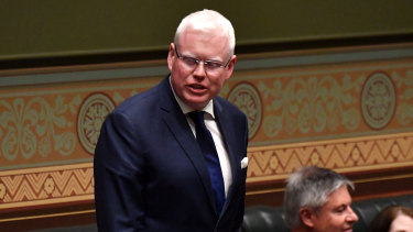 NSW Disability Minister Gareth Ward says the federal government is prioritising its budget surplus over the NDIS.
