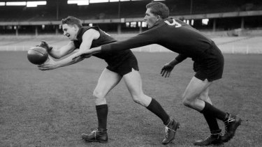 Melbourne's 'Hassa' Mann gets to the ball in front of his cousin, ruckman Lenn Mann, at training prior to the 1960 VFL grand final.