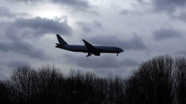 A plane comes in to land at Gatwick Airport in England.