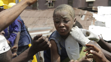A child is rescued from the rubble of a collapsed building in Lagos, Nigeria.