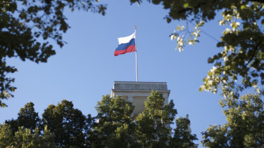 The Russian national flag waves on top of the Russian embassy in Berlin, Germany. A Briton working at the nearby British embassy was arrested on Tuesday accused of passing on secrets to Russia.