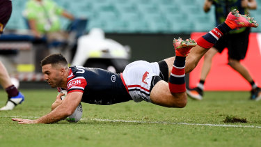 James Tedesco scores one of his three tries on the opening weekend of the season.