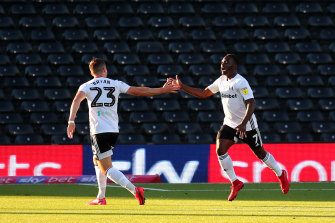 Neeskens Kebano celebrates after scoring for Fulham in the second leg against Brentford.  The Londoners advanced to the play-off final despite a 2-1 loss to Cardiff City.