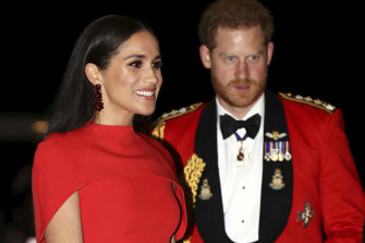"""Prince Harry and Meghan, Duchess of Sussex arrive at the Royal Albert Hall in London in March. A new book promises to revisit the moments leading up to their """"divorce"""" from the royal family."""