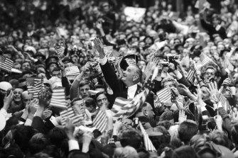 Lyndon Johnson amongst adoring crowds in Swanston Street.
