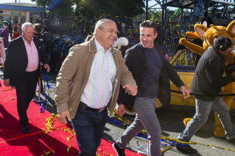 Gold Coast Mayor Tom Tate (left) at the reopening of Warner Bros Movie World Theme Park following pandemic lockdowns in 2020.
