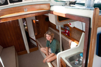 The 16-year-old Watson aboard her boat around six months before setting off in October 2009.
