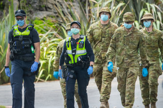 Australian Defence Force personnel and Victoria Police in Fitzroy Gardens in Melbourne.