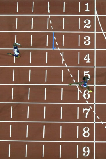 American runner Michael Johnson takes the last step before Olympic gold in the men's 400m final at Stadium Australia.