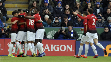 Manchester United's players celebrate Marcus Rashford's goal again Leicester at the King Power Stadium in Leicester on Sunday.