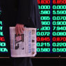 ASX ends flat as banks gain, gold miners fall
