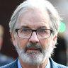 'Scandalous lie': John Jarratt denies raping woman to police in court video
