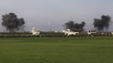 Columns of smoke raise after air strikes hit town of Saraqeb, in Idlib province, Syria, on Thursday.