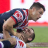 Strained relationship: Former teammates Cooper Cronk and Cameron Smith collide in the 2018 grand final.