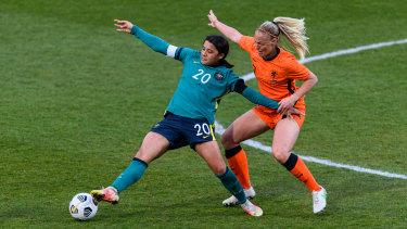 The Netherlands' Stefanie van der Gragt  (right) is hot on the heels of Australia's Sam Kerr.