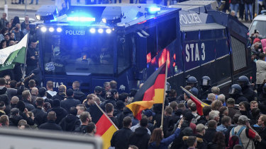 A police water cannon stands between far-right demonstrators in Chemnitz, eastern Germany, last week.