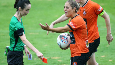 Early shower: Brisbane's Katrina Gorry reacts after being given a red card for her second bookable offence.