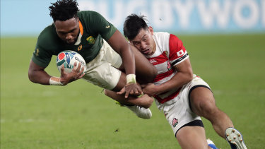 Japan's Ryoto Nakamura, right, tackles South Africa's Lukhanyo Am.