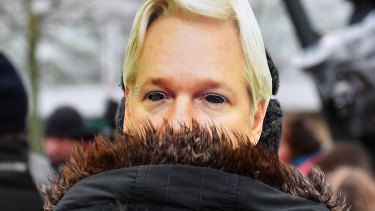 A protester wears a mask of Julian Assange's face outside Belmarsh prison prior to the extradition hearing of WikiLeaks founder Julian Assange.