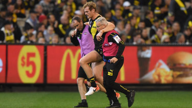 Another blow: More injury woe for Richmond after David Astbury was escorted from the ground.