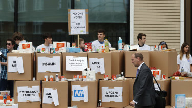 Anti-Brexit activists protest as they deliver a pile of medical supplies in cardboard boxes to the Department of Health and Social Care in London.