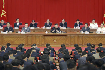 Kim, centre, warned about possible food shortages and called for his people to brace for extended COVID-19 restrictions.