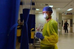 St Vincent's Hospital Registered nurse Damien Davis Frank holding a testing swab for a COVID-19 rapid test.