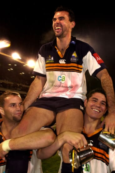 Joe Roff, centre, and team mates Peter Ryan and Jeremy Paul celebrate the Brumbies' Super 12 win in 2001.