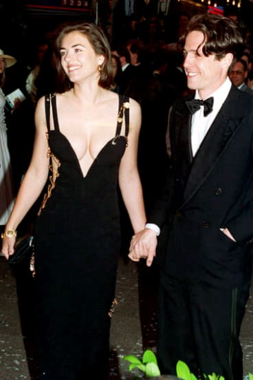 Liz Hurley, wearing the iconic Versace dress, with her then boyfriend Hugh Grant in 1994.