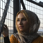 Amina Abdulkhaleq, 25, looks out at the Syria-Iraq border
