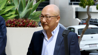 Former Dreamworld employee Bob Tan arrives to give evidence at the inquest.