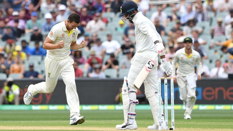 Rare respite: Josh Hazlewood celebrates the wicket of Lokesh Rahul, whose occasional wildness was the exception not the rule.