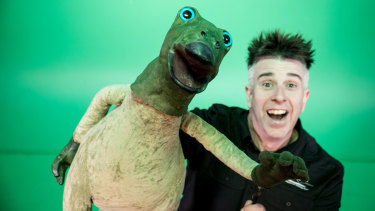 David Cannell, right, and Mutty the Muttaburrasaur.
