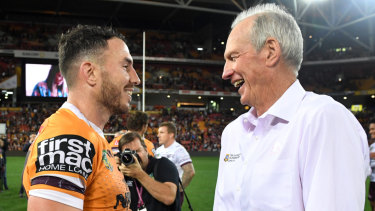 Former Broncos captain-coach partnership Darius Boyd (left) and Wayne Bennett in 2018 before the coach moved to South Sydney.