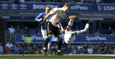 Richarlison scores for Everton against Manchester United at Goodison Park.