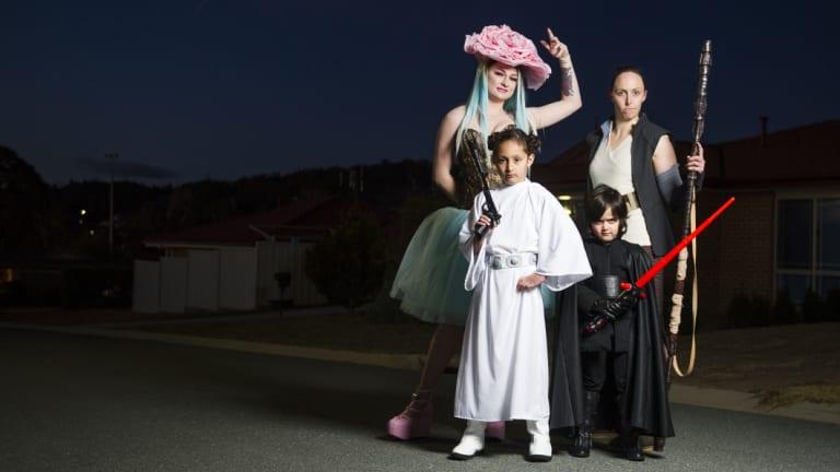 Cosplayers (from left) Isabella Hurst (as Venusaur), Alysha Khokhar (as Rey), Sophie Khokhar (as Princess Leia) and Elijah Khokhar as Kylo Ren.