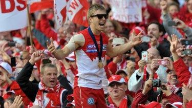 Kieren Jack laps up the glory after Sydney's 2012 AFL grand final win.