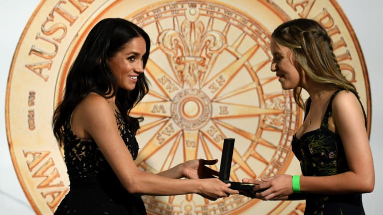 Meghan, the Duchess of Sussex presents Sophia Skarparis with her award on Friday night.