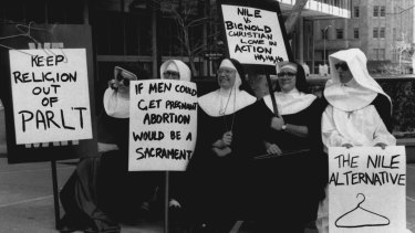 "These ""nuns"" made their anti-abortion bill message clear, marching from Town Hall to Sydney Hospital."