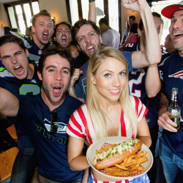Waitress Emma King and Super Bowl fans in Paddington in 2015.