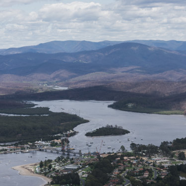 An aerial photo of bushfire affected areas on the outskirts of Batemans Bay taken from an MRH90 Taipan helicopter.